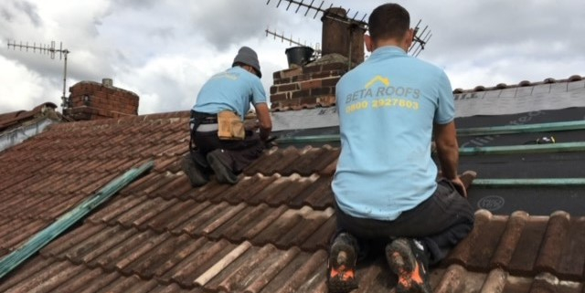 the Beta Roofs Team on a roof